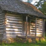 Authentic 1870's Log Cabin fully furnished and available to see, located on the grounds of the Baxter Springs Heritage Center & Museum.